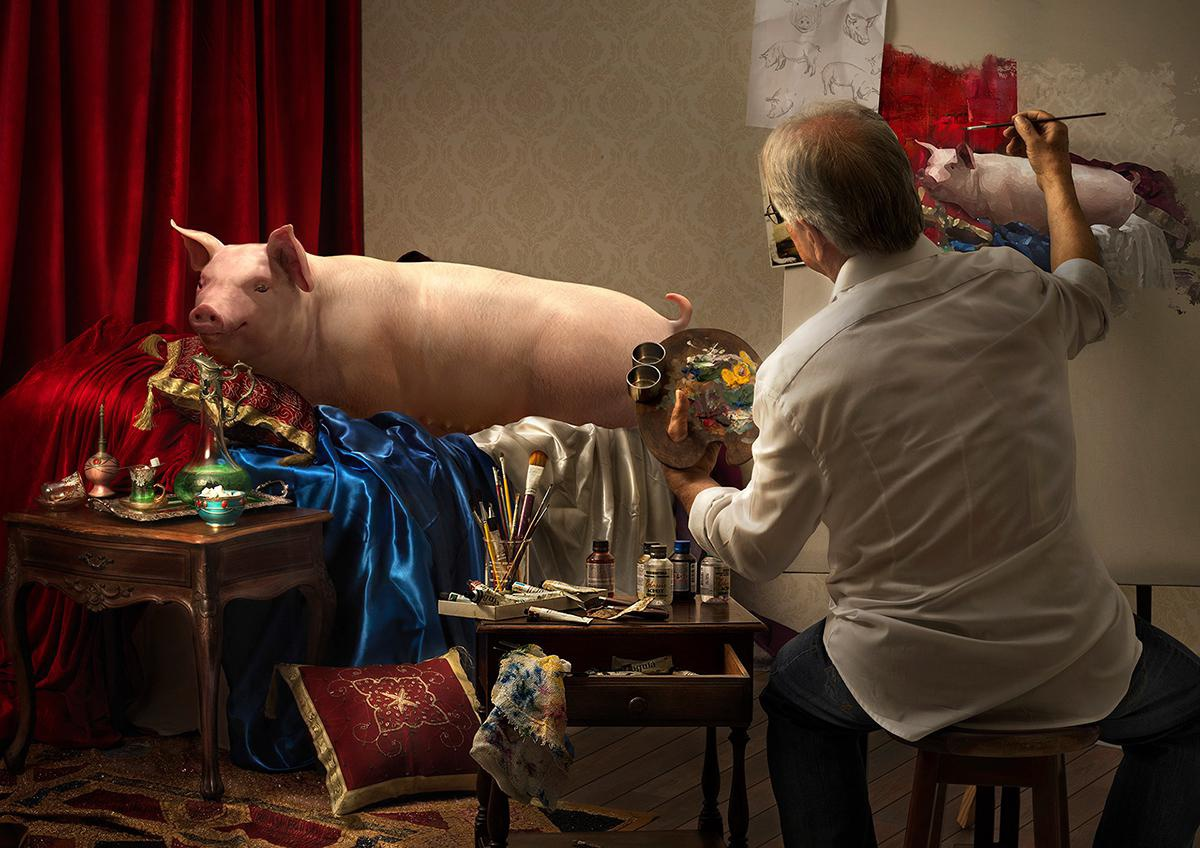 man drawing pig