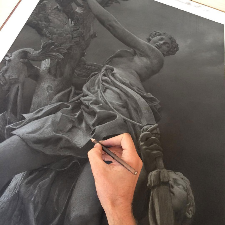 Compressed charcoal layer with white conté built up over the top