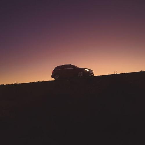 car in sunset desert