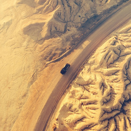 over head car in desert