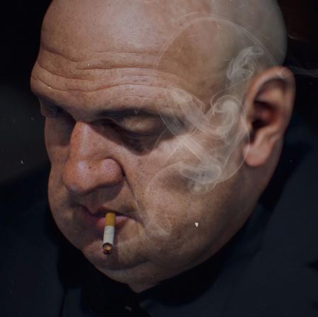 bald man smoking