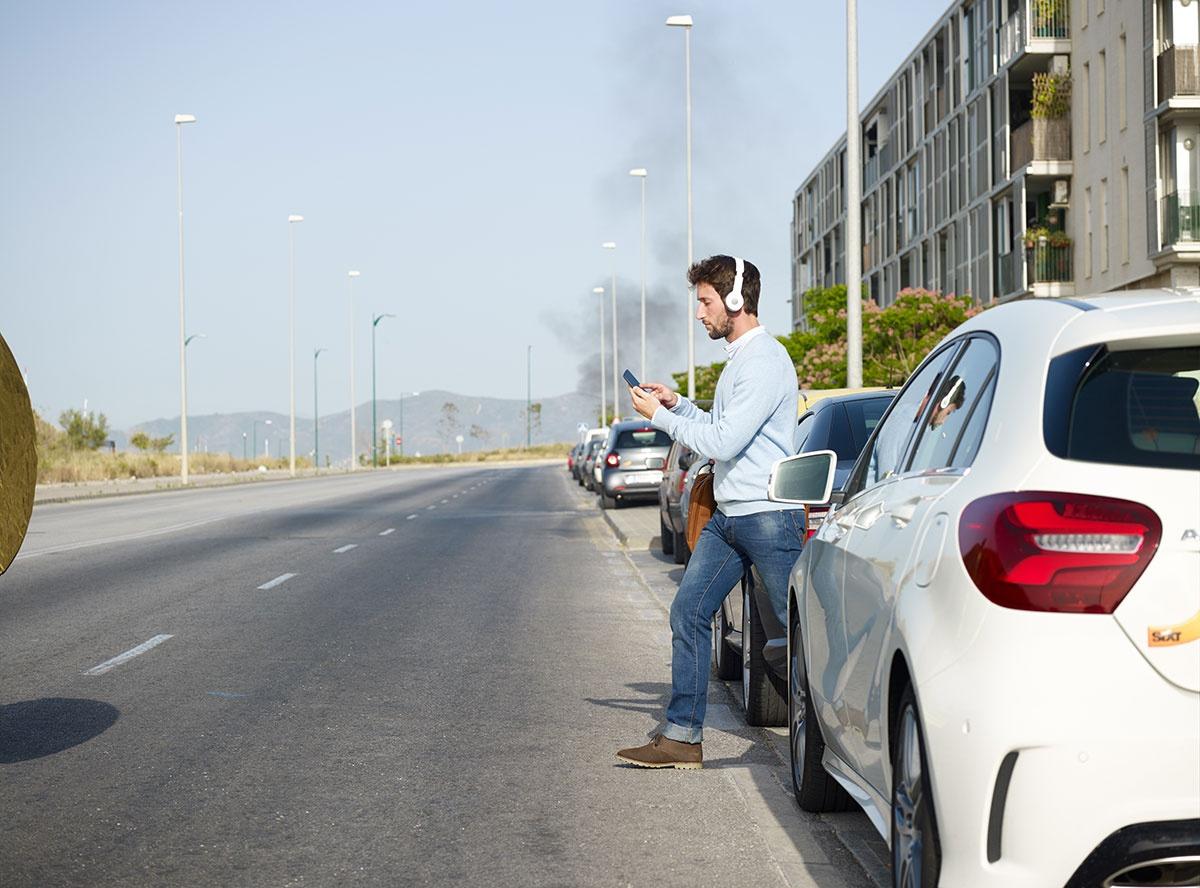 man on phone crossing road